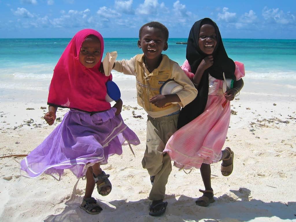 kids playing on zanzibar beach