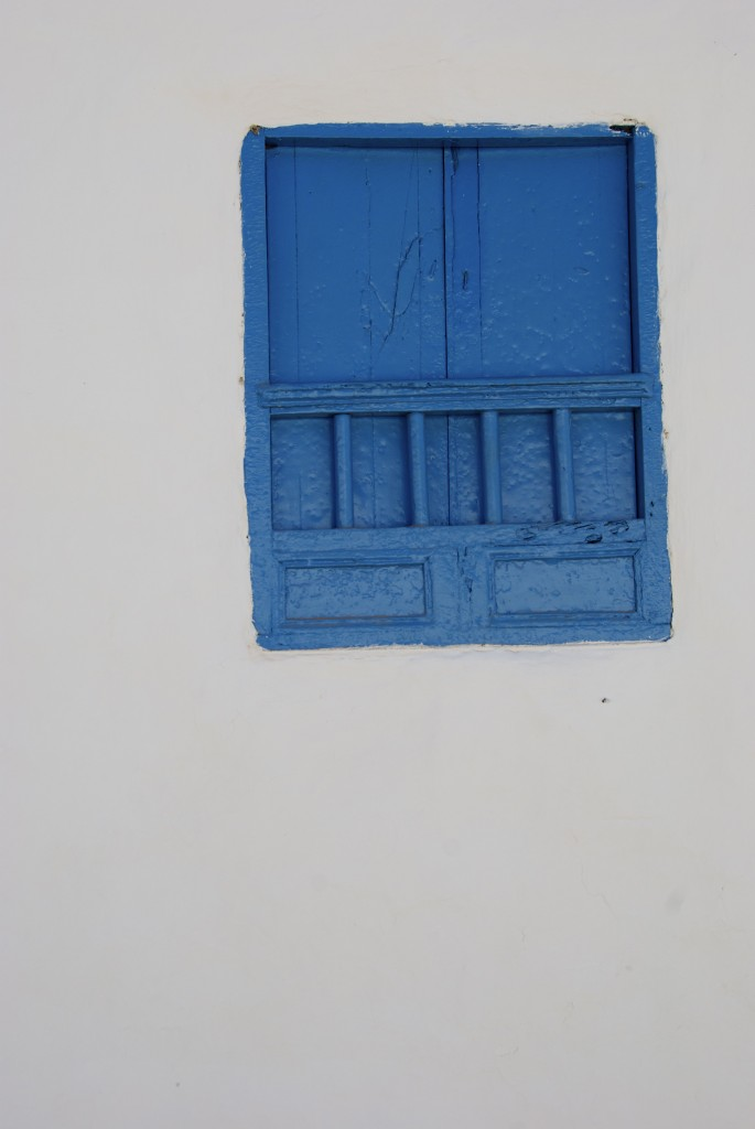 blue painted window in Barichara, Colombia
