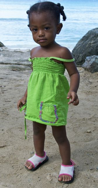 very cute local Tobago child posing for a picture