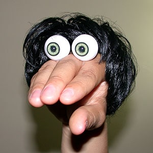 hand made to look like a puppet with long hair