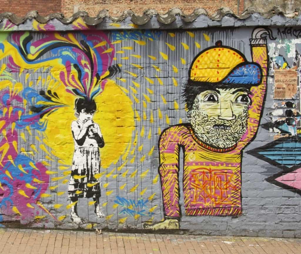 yellow baseball cap bogota street art graffiti