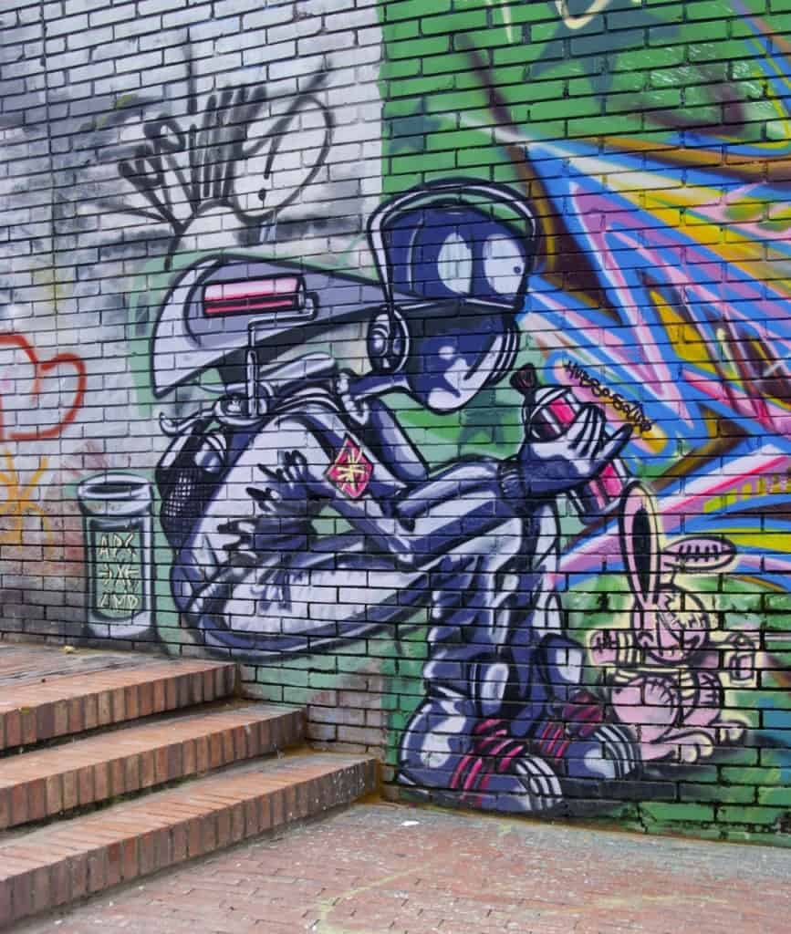 kid spray can bogota street art graffiti