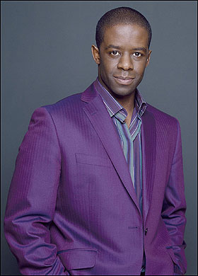 adrian lester hustle purple suit