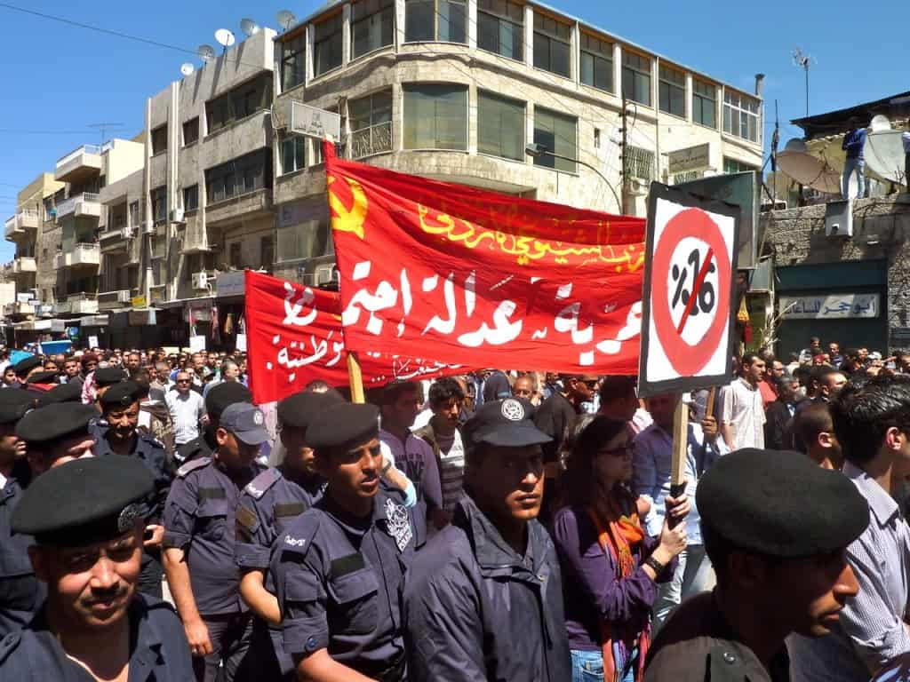 marching after friday prayers in amman Jordan