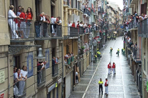 running of the bulls in pamplona watching from the balcony