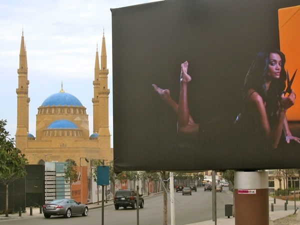 beruit juxtoposition - nudity sign and a mosque