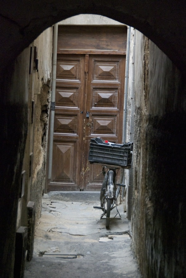 bike in hallway in alley at damascus souk