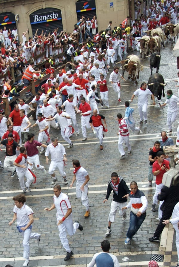 bulls approaching dead man's corner in running of the bulls in pamplona