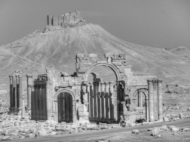 Palmyra Entrance Arch with Crusader Castle in background