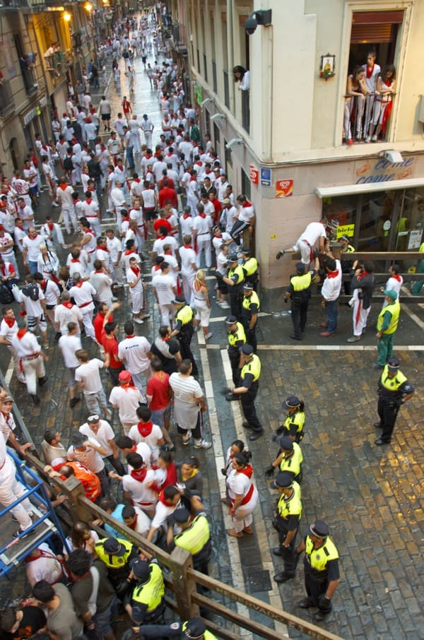 police push back crowd before running of the bulls in pamplona