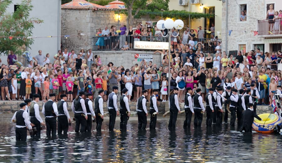 Donkey Band playing in the harbor water at Sali Croatia