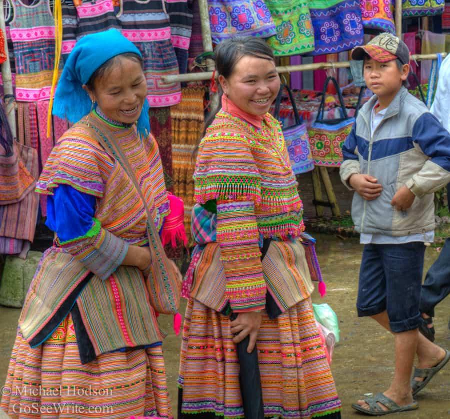 hmong women smiling at Bac Ha Vietnam market