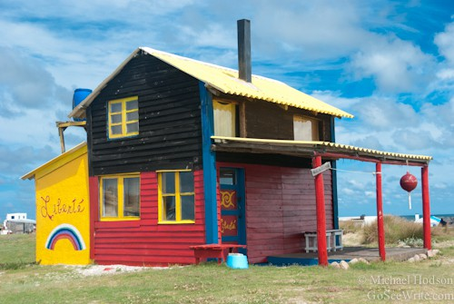 red yellow black painted house cabo polonio uruguay beach town