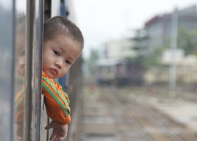 utc photo of a cute chinese kid on a train