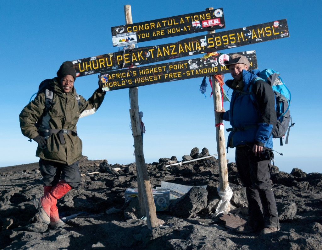 michael hodson with guide summit Kilimanjaro