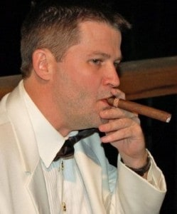 michael hodson smoking cigar white tuxedo jacket