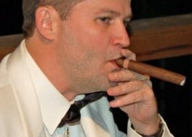 michael hodson smoking cigar white tuxedo jacket