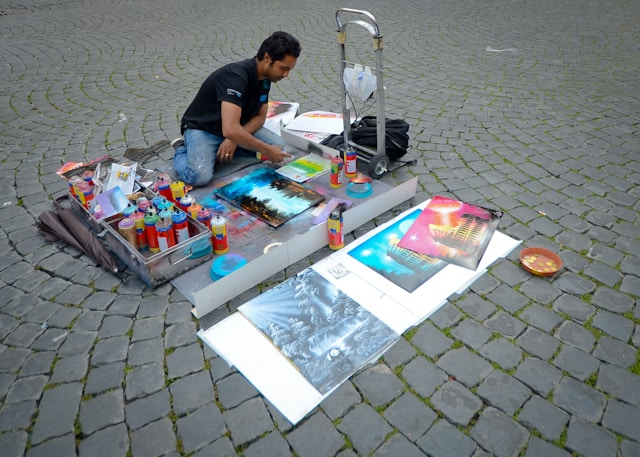 painter doing street art in rome italy
