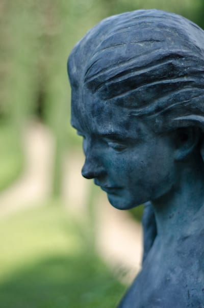 blue woman statue in costa brava spain