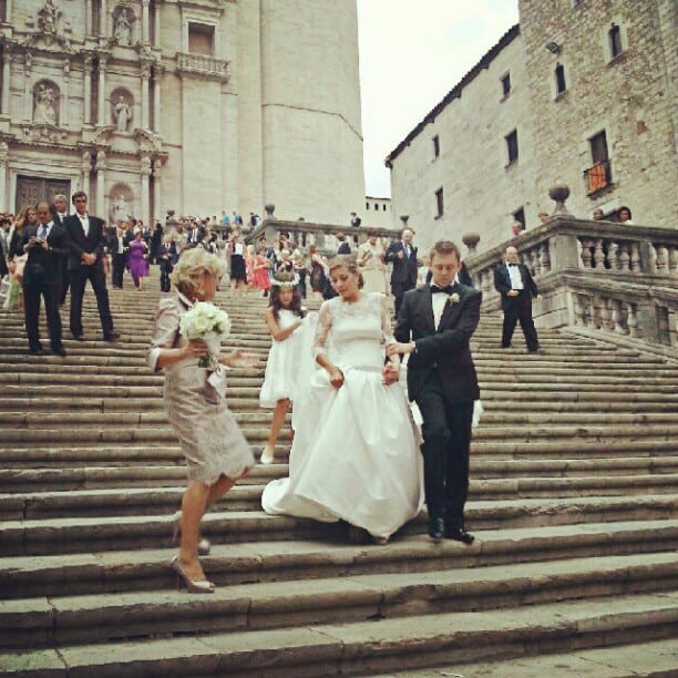 bride and groom coming down cathedral steps in girona
