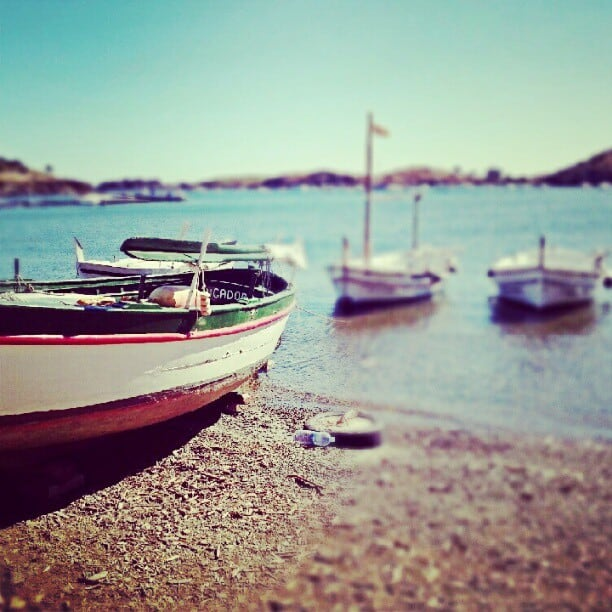 tilt shift of small boats on sandy beach in spain