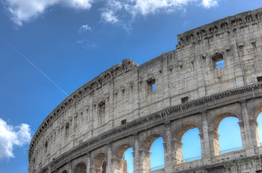 things to see in rome the colosseum with blue sky