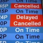 airport sign with delayed and cancelled flights