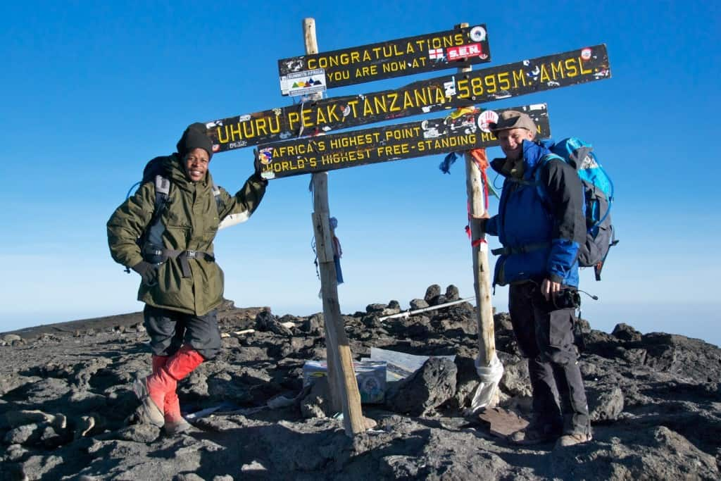michael hodson and guide on kilimanjaro peak