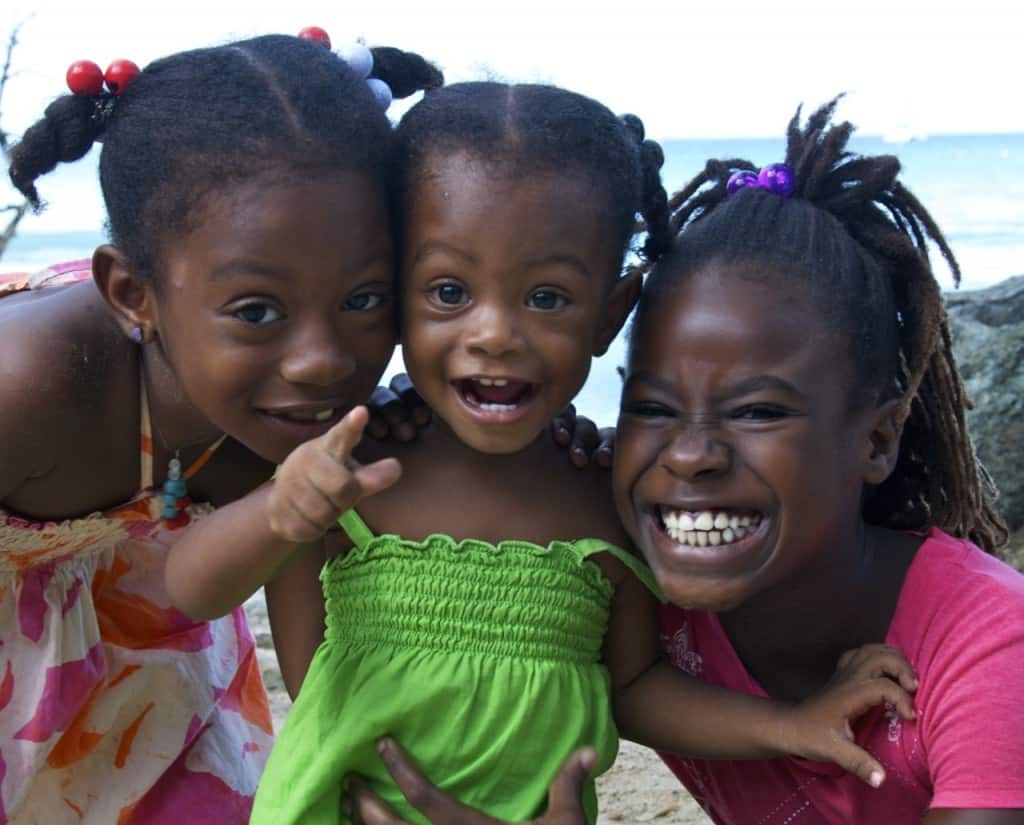 three local Tobago kids pose for a happy picture