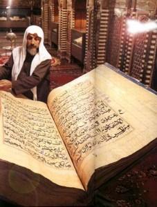 man reading a quran