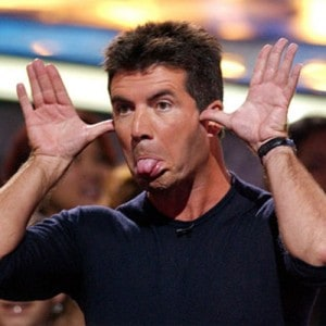 simon cowell funny sticking tongue out