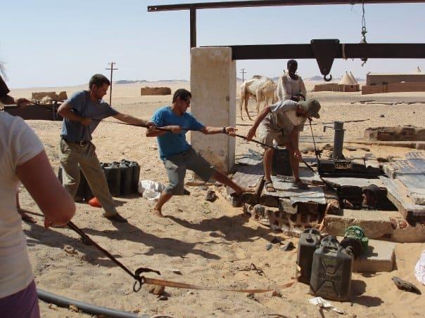 pulling up well water sudan desert
