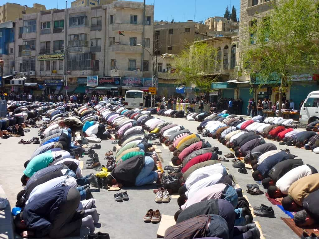 muslim men at friday islam prayers outside in Jordan