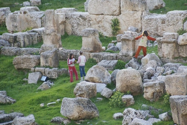 kids playing in baalbek ruins