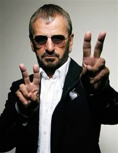 Ringo Starr giving peace sign