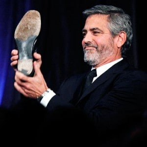 george clooney with shoe in italy