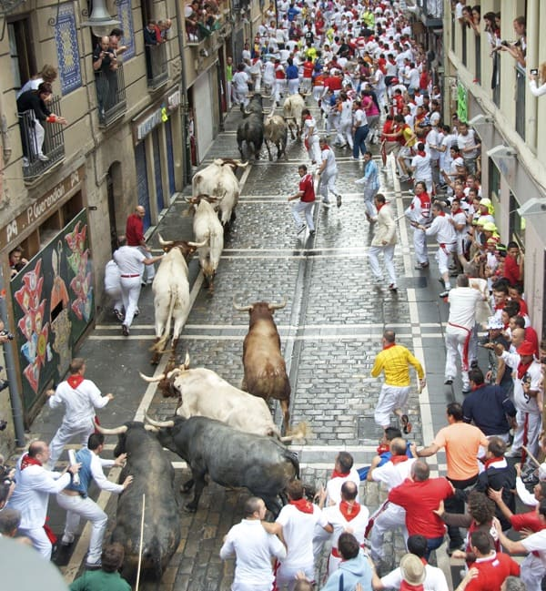 bulls going around dead man's corner at pamplona's running of the bulls