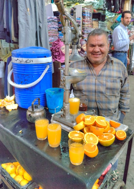 orange juice seller in damascus souk market