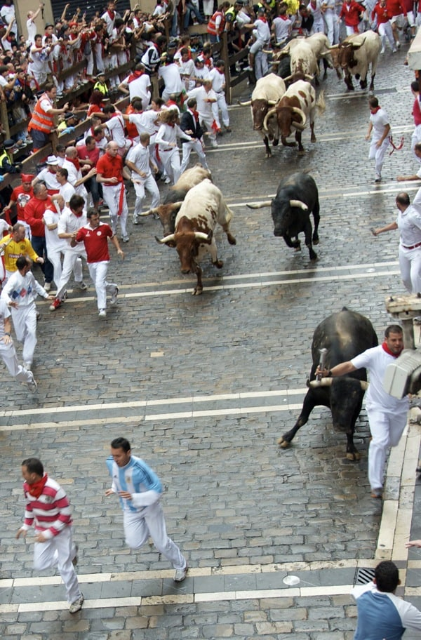 guy about to get trampled, running with the bulls in pamplona