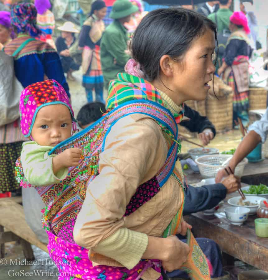 hmong woman with baby at Bac Ha market vietnam