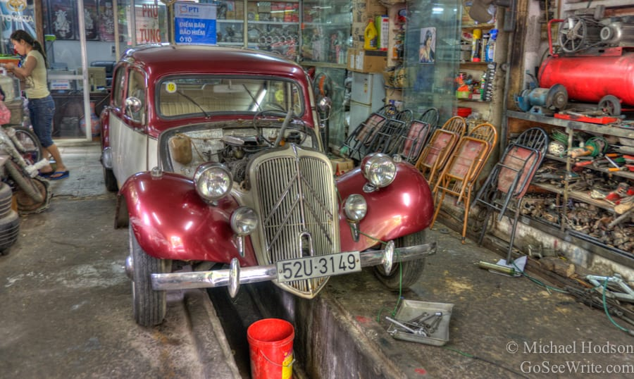 old red car in hanoi garage