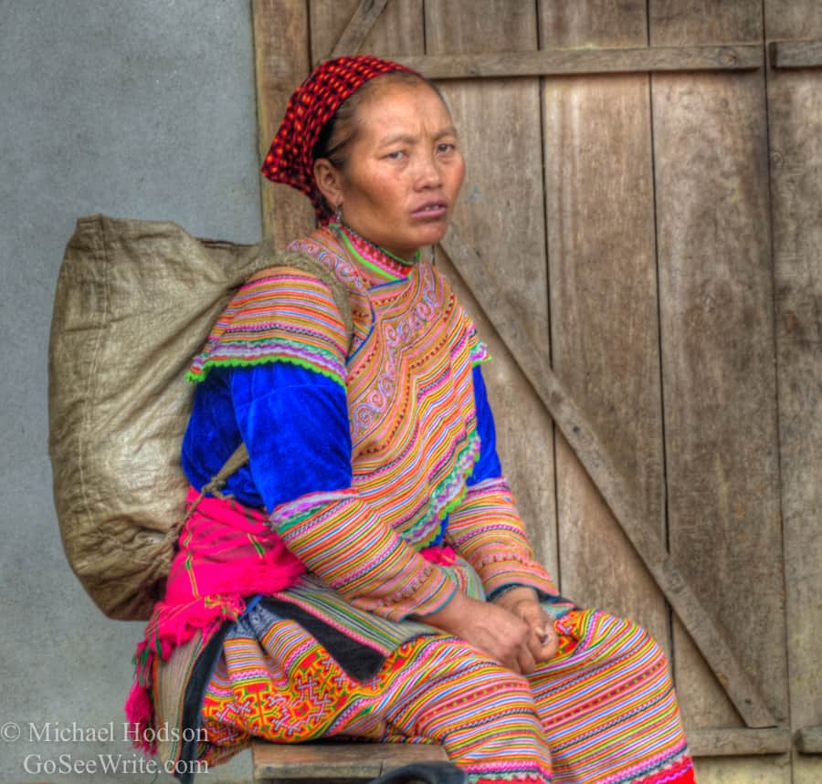 sad hmong woman in colorful outfit