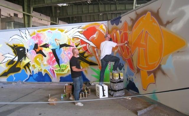 live graffiti demonstration at berlin music festival at tempelhof airport
