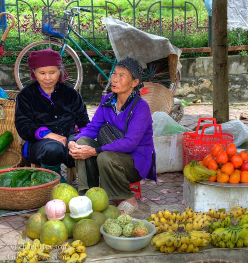 hmong women selling fruit at market