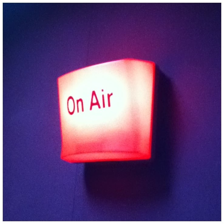 on air sign radio show, sign from radio show displaying on-air