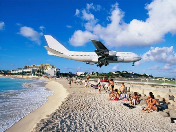 plane landing over beach