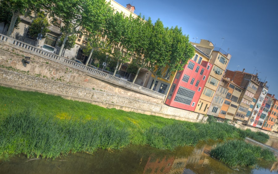 girona spain river colorful buildings