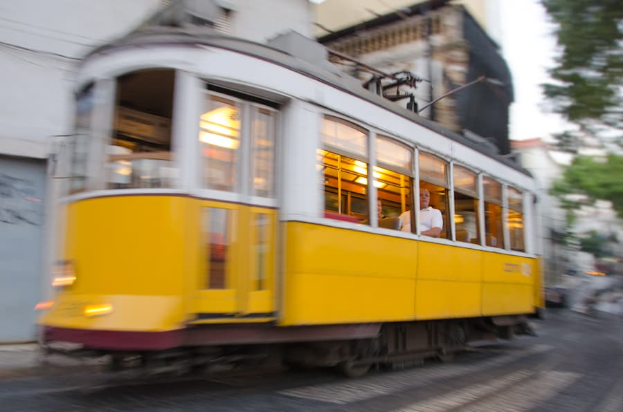 yellow lisbon streetcar in motion