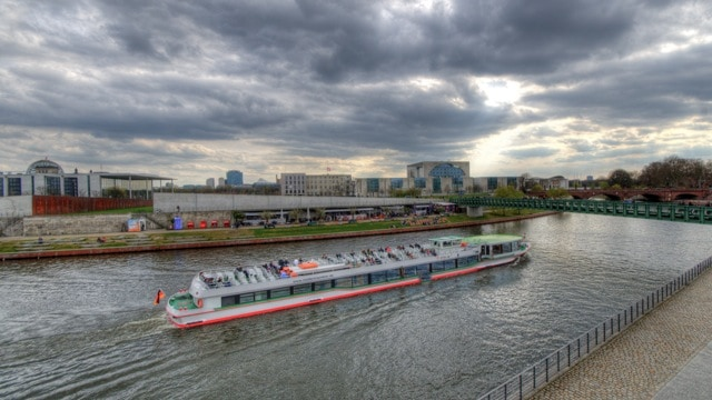 berlin river with boat in hdr stormy afternoon