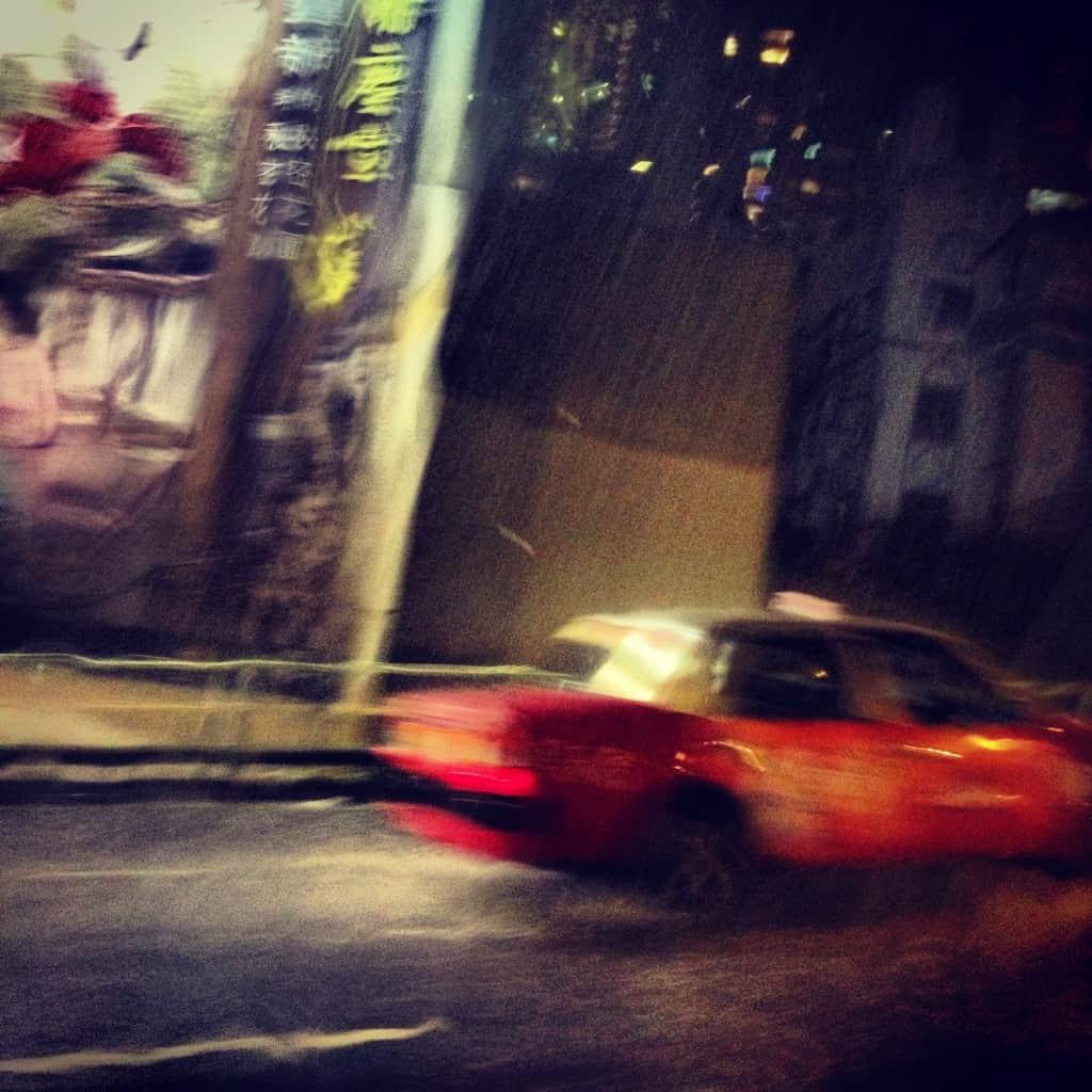 Taxi in a typhoon, hong kong